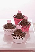Chocolate cupcakes with pink hearts