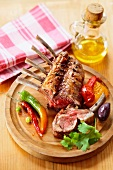 Grilled rack of beef with peppers on a wooden board