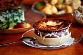 Bowl of French Onion Soup on a Glass Plate