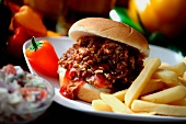 Chopped Barbecue Beef Sandwich on a Bun with French Fries