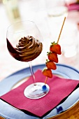 Chocolate mousse with a skewer of strawberries