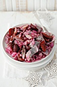 A salad of herring with preserved plums and red onions (Christmassy)