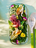 Vegetable salad with deep-fried courgette flowers and dry-cured ham