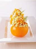 Yellow tomatoes filled with caviar and millet
