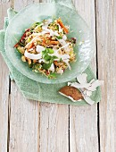 Basmati rice with fried vegetables, coconut and coriander leaves