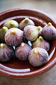 Fresh figs in a clay dish