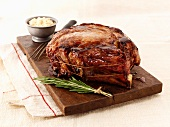 Roast beef and rosemary on a chopping board