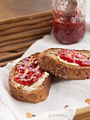 Two Slices of Multi-Grain Toast with Butter and Strawberry Jam