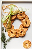 A wreath made of piped biscuits