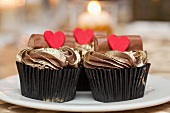 Cupcakes topped with gold icing and hearts
