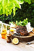Grilled rib eye steak with a chilli salt crust, lemons and rocket