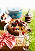 Almond cake with berries and cherries, for a picnic