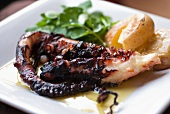 Flame-grilled octopus with potatoes