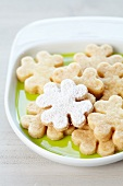 Shamrock-shaped biscuits, dusted with icing sugar