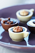 Filled chocolates in the shape of coffee cups