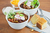 Chilli con carne with sour cream and corn bread
