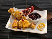 Pastry parcels with pomegranate and orange zest