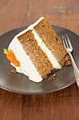 A slice of carrot cake with cream cheese icing (USA)