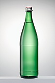 A green bottle filled with water