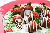 Strawberries coated with white and dark chocolate