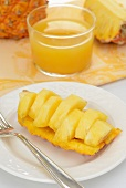 A pineapple 'boat' of pineapple chunks
