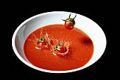 Tomatoes falling into tomato soup