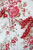 Redcurrants on floral material