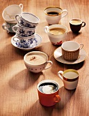 An assortment of coffee cups and varieties of coffee