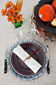 A place setting with autumnal decorations