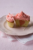 Vanilla Cupcake with a Pink Heart Center and Pink Frosting; Halved
