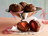 A chocolate muffin filled with strawberries