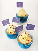 Three cupcakes decorated with buttercream and EU flags
