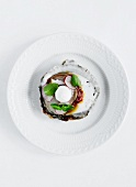An oyster with radishes and basil
