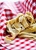 Home-made fresh pasta on a gingham cloth