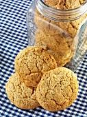 Sugar biscuits, some in a storage jar