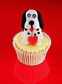 A cupcake topped with a dog for Valentine's Day