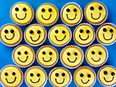 Four funny smiley cupcakes