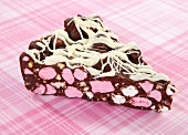 A slice of rocky road cake with marshmallows (USA)