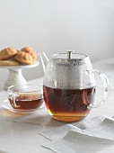 Clear Glass Tea Pot with Tea; Cup of Tea and Gluten Free Cakes
