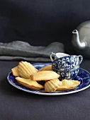 Madeleines on a Plate with Tea Cups