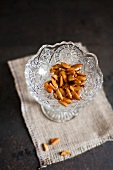 Roasted almonds in a crystal dish