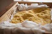 Bulgur fermenting on a wooden tray