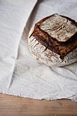 Home-made sourdough bread on a linen cloth