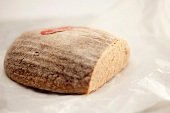 A loaf of bread, cut, with flour