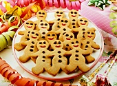 Lots of gingerbread men on a plate for a party