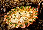 Fish roulades and prawns with lemon