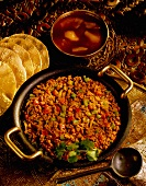 Lamb curry with mango chutney and poppadoms (India)