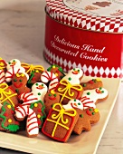 Assorted Decorated Christmas Cookies on a Platter with Cookie Tin in the Background