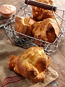 Popover on a Dish Cloth with Popovers in a Wire Basket