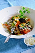 Mussels in white wine with matchstick vegetables